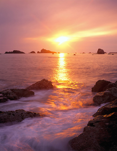 Pacific Ocean surf and sunset at Crescent City, California, USA. John offers private photo tours in Washington and throughout Colorado. Year-round.