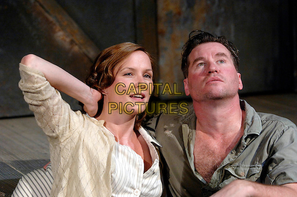 "CHARLOTTE EMMERSON & VAL KILMER.""The Postman Always Rings Twice"" production photocall.The Playhouse Theatre.London 31 May 2005..half length dirty sweaty hairy chest green shirt open play costume stage looking up.www.capitalpictures.com.sales@capitalpictures.com.©Capital Pictures"