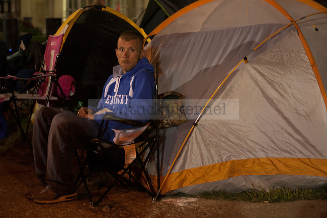 A UK fan sits outside of Memorial Coliseum, waiting for Big Blue Madness tickets to go on sale in Lexington, Ky., on Wednesday, September 17, 2014. Photo by Adam Pennavaria   Staff