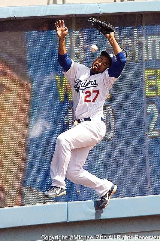 LOS ANGELES, CA - APRIL 09: Outfielder Matt Kemp #27 of the Los Angeles Dodgers jumps up and hits the wall while trying to catch a fly ball against the Colorado Rockies on April 9, 2007 at Dodger Stadium in Los Angeles, California. The Rockies defeated the Dodgers 6-3
