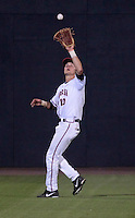 Virginia outfielder Brandon Downes (10) makes a catch during the game against Arkansas Saturday night at Davenport Field in Charlottesville, VA. Photo/The Daily Progress/Andrew Shurtleff