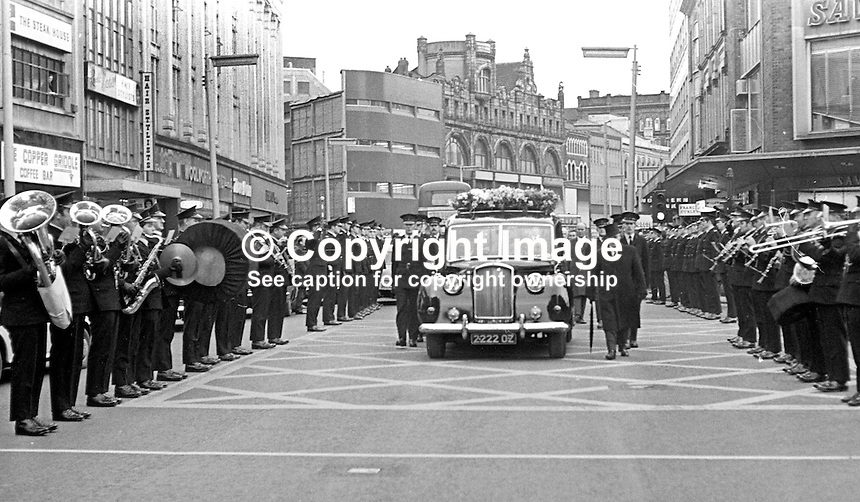 RUC band in attendance at the funeral of Constable David Montgomery passes through the city centre in Belfast, N Ireland on 29th January 1972. Constable Mongomery, along with another police officer, Sergeant Peter Gilgun, died in a Provisional IRA gun attack on 27th January 1972 on Creggan Road, Londonderry.  Constable Montgomery had been due for a transfer from Londonderry but had been allowed to stay on until June when he planned to marry a 19 year old local girl. 197201290063c<br />