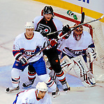 15 November 2008:  Philadelphia Flyers' left wing forward Scott Hartnell stands in the crease between defenseman Josh Gorges (26) and goaltender Jaroslav Halak from Slovakia in the first period at the Bell Centre in Montreal, Quebec, Canada.  The Canadiens, celebrating their 100th season, fell to the visiting Flyers 2-1. ***Editorial Sales Only***..Mandatory Photo Credit: Ed Wolfstein Photo *** Editorial Sales through Icon Sports Media *** www.iconsportsmedia.com