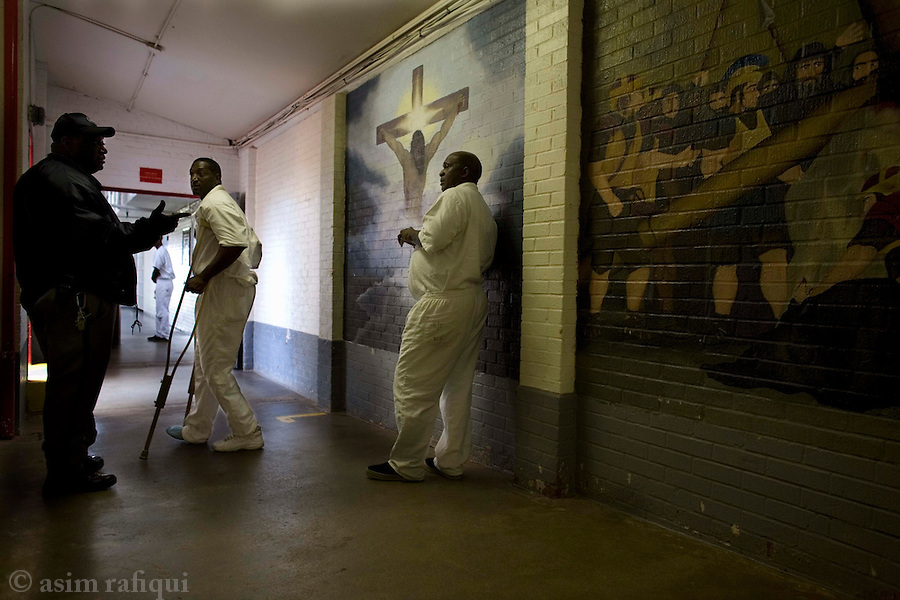 Christian murals decorate the halls of the prison<br />