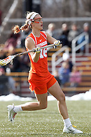 Syracuse University midfielder Katie Webster (18) passes the ball.   Syracuse University (orange) defeated Boston College (white), 17-12, on the Newton Campus Lacrosse Field at Boston College, on March 27, 2013.