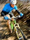 USA, California, motion blur of man mountain biking, Marin County