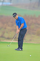 Duan Chen Xiao (CHN) putts on the 14th green during Friday's Round 2 of the 2014 BMW Masters held at Lake Malaren, Shanghai, China 31st October 2014.<br /> Picture: Eoin Clarke www.golffile.ie