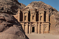 Monastery or Al-Deir, 1st century BC, Petra, Ma'an, Jordan. This was probably originally a Nabatean temple, maybe dedicated to King Obodas I and used as a hall for memorial feasts, but was later used as a Byzantine church or monastery. It sits in the mountains above Petra and is 50m high. The man seated in the plaza shows the huge scale of the edifice. Petra was the capital and royal city of the Nabateans, Arabic desert nomads. Picture by Manuel Cohen