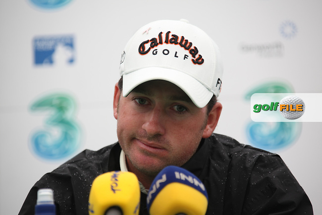 Graeme McDowell announcing just as play was about to start that he would not be continueing on day 3 one at the 3 Irish open in Co Louth Golf Club...Photo: Fran Caffrey/www.golffile.ie..