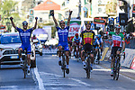 Deceuninck-Quick Step team mates Zdenek Stybar (CZE), Philippe Gilbert (BEL), Yves Lampaert (BEL) and Elia Viviani (ITA) celebrate another win as they cross the finish line at the end of the 110th edition of Milan-San Remo 2019 running 291km from Milan to San Remo, Italy. 23rd March 2019.<br /> Picture: LaPresse/Gian Matteo D'Alberto | Cyclefile<br /> <br /> <br /> All photos usage must carry mandatory copyright credit (&copy; Cyclefile | LaPresse/Gian Matteo D'Alberto)