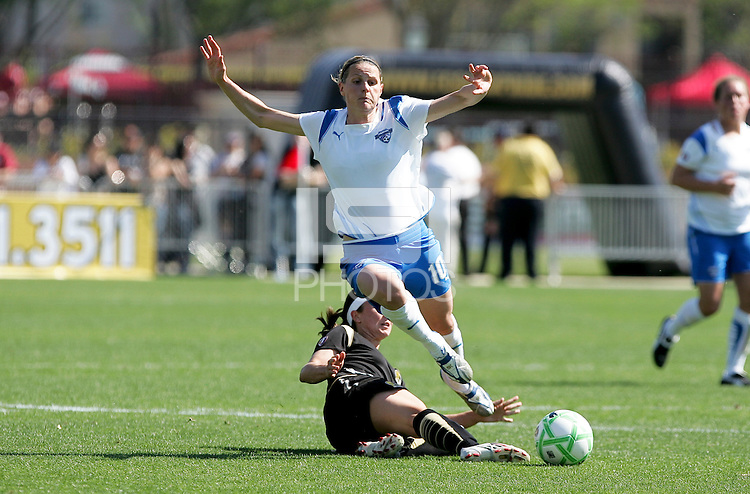 Tiffany Weimer (bottom) slide tackles Kelly Smith. FC Gold Pride defeated the Boston Breakers 2-1 at Buck Shaw Stadium in Santa Clara, California on April 5th, 2009. Photo by Kelley Cox /isiphotos.com