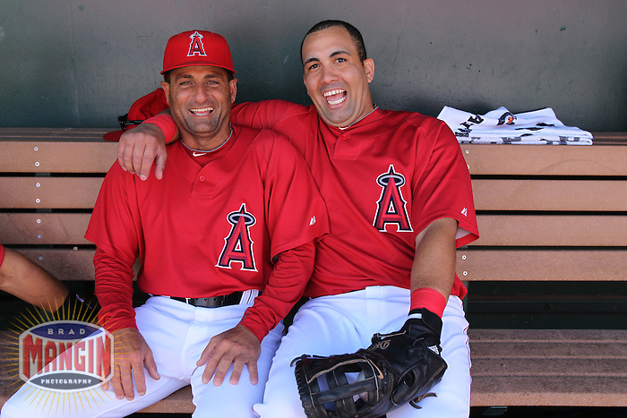 TEMPE - MARCH 10:  Kendry Morales (right) and coach Dino Ebel of the Los Angeles Angels of Anaheim hang out in the dugout before a spring training game against the Cincinnati Reds on March 10, 2010 at Tempe Diablo Stadium in Tempe, Arizona. (Photo by Brad Mangin)
