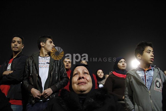 """Relatives of al-Ahly fans, who were killed in what known as the """"Port Said massacre"""", attend the third anniversary of killing their relatives at al-Ahly club's training stadium, on February 1, 2015. On 1 February 2012, a massive riot occurred at Port Said Stadium in Port Said city, Egypt, following an Egyptian Premier League football match between El Masry and El Ahly clubs. At least 74 people were killed and more than 500 were injured after thousands of El Masry spectators stormed the stadium stands and the pitch. Photo by Amr Sayed"""