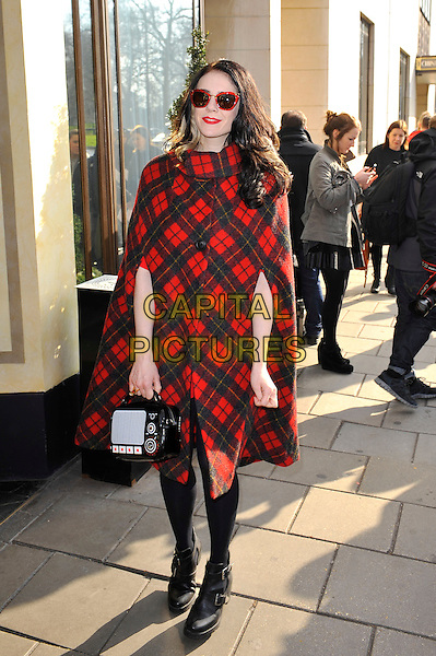 Kate Nash.attending the Temperley London a/w 2013 catwalk show, Dorchester Hotel, London, England. .17th February 2013.London Fashion Week LFW full length black tights plaid tartan check cape sunglasses shades radio bag purse coat jacket poncho red   .CAP/MAR.© Martin Harris/Capital Pictures.