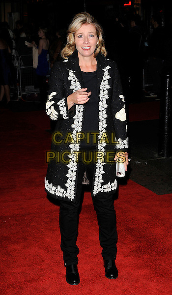 "EMMA THOMPSON .At The Times BFI 53rd London Film Festival Gala Screening of ""An Education"" at the Vue West End, Leicester Square, London, England, UK, October 20th 2009..full length black coat white patterned trim trousers clutch bag leaf leaves hand finger gesture pointing .CAP/CAN.©Can Nguyen/Capital Pictures."