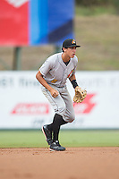 West Virginia Power shortstop Cole Tucker (2) on defense against the Kannapolis Intimidators at Intimidators Stadium on July 3, 2015 in Kannapolis, North Carolina.  The Intimidators defeated the Power 3-0 in a game called in the bottom of the 7th inning due to rain.  (Brian Westerholt/Four Seam Images)