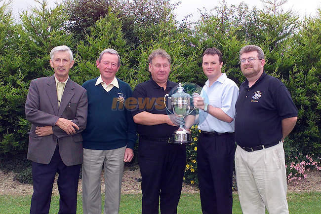 Presentation of the Frank Hanlon Memorial cup to Oliver Cassidy by Frank hanlon jnr pictures with far right Michael Foley Captain, Left John Gilmore Course Owner and paschal O'connor president Tullyallen Golf Club...Picture Fran Caffrey Newsfile.