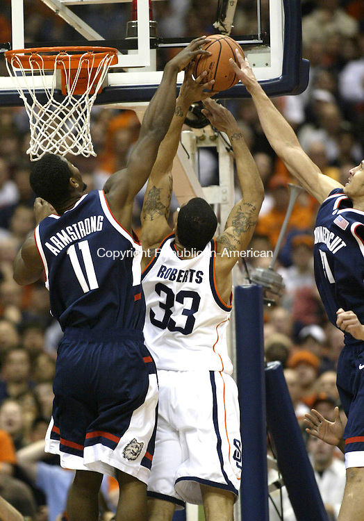 SYRACUSE, NY 16 JANUARY 2005 011605BZ12-      UConn #11, Hilton Armstrong and 21, Josh Boone block the shot of Syracuse #33, Terrence Roberts<br /> <br /> <br /> <br /> during their game at the carrier Dome at Syracuse University Monday night. <br /> Jamison C. Bazinet Republican-American