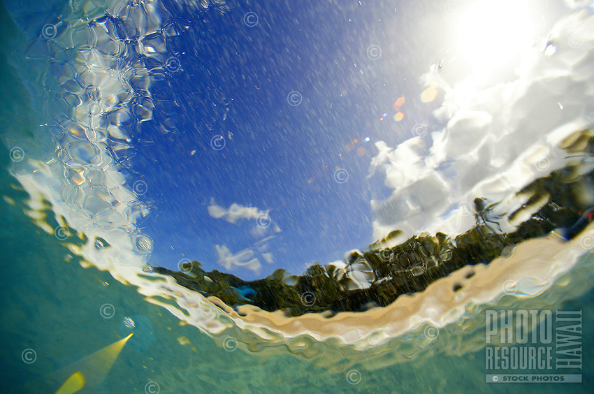 underwater photography of wave breaking on the beach under the sun