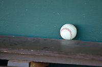 A baseball sits on top of the bench in the home dugout prior to the game between the Durham Bulls and the Charlotte Knights at Knights Stadium on August 2, 2011 in Fort Mill, South Carolina.  The Bulls defeated the Knights 18-3.   (Brian Westerholt / Four Seam Images)