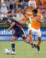 Chivas USA forward Juan Pablo Garcia (10) dribbles through Houston Dynamo midfielder Ricardo Clark(13).  Houston Dynamo beat CD Chivas USA 2-0 at Robertson Stadium in Houston, TX on October 29, 2006 to gain a berth in the Western Conference Final on a 3-2 aggregate.