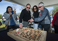 NWA Democrat-Gazette/BEN GOFF @NWABENGOFF<br /> Jessica Presley (from left), Bill Schwab, executive director of the Pryor Center, Laura Jacobs, associate vice chancellor at the University of Arkansas, and Dan Ferritor, former University of Arkansas chancellor, looks at a model Friday, April 12, 2019, during a groundbreaking ceremony for the New Beginnings facility in Fayetteville.