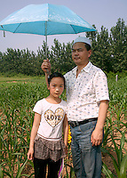 China / Henan Province / Luoyang / Mapo village / 28.6.2013 / Sufeiya and her father,  Ding Shixiao, pose for a portrait during the 36th anniversary of the death of the great-grandfather of Ding Lan.<br /> © Giulia Marchi