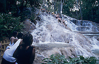 Natives watching Tourist forming human chain, Dunn's River Falls, Ocho Rios, Jamaica, January 2005