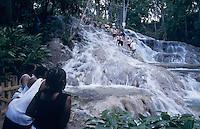 Natives watching Tourist forming human chain, Dunn's River Falls, Ocho Rios, Jamaica, January 2005