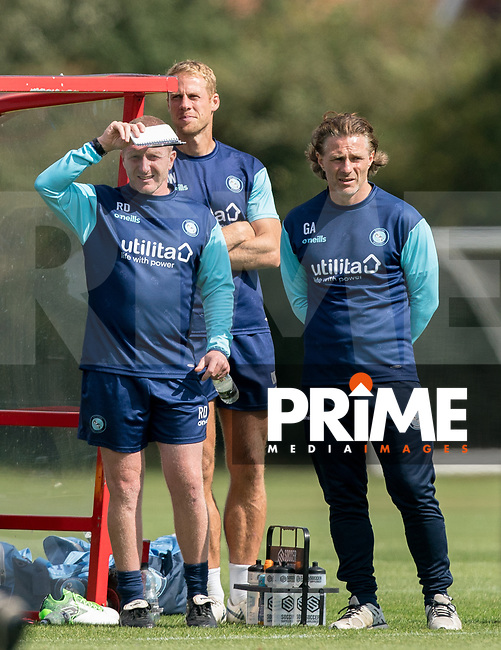 (L-r) Wycombe Wanderers Assistant Manager Richard Dobson, Wycombe Wanderers Sports Scientist David Wates & Wycombe Wanderers Manager Gareth Ainsworth during the behind closed doors friendly between Brentford B and Wycombe Wanderers at Brentford Football Club Training Ground & Academy, 100 Jersey Road, TW5 0TP, United Kingdom on 3 September 2019. Photo by Andy Rowland.