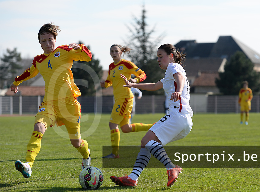 20150406 - OZOIR , FRANCE  : Romanian Kinga Barabasi pictured in a duel with French Maelle Garbino (right) during the soccer match between Women Under 19 teams of France and Romania , on the second matchday in group 3 of the UEFA Elite Round Women Under 19 at Stade des 3 Sapins , Ozoir La Ferriere , France . Monday 6th April 2015 . PHOTO DAVID CATRY