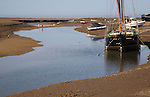 Boats at low tide at Blakeney, Norfolk, England