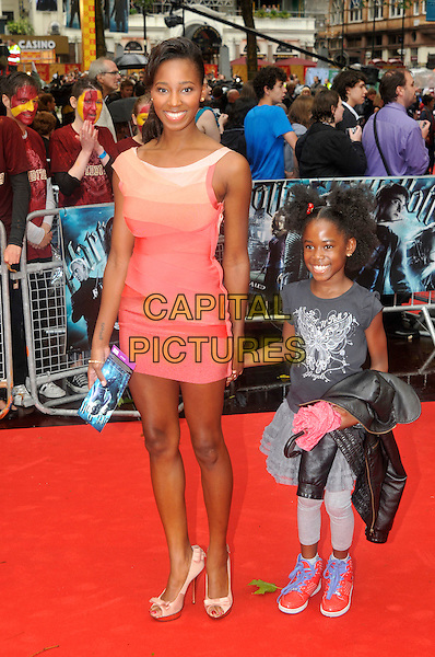 "JAMELIA aka Jamelia Niela Davis & daughter .Arriving at the World Premiere of ""Harry Potter and the Half-Blood Prince"" at the Odeon cinema, Leicester Square, London, England, UK, July 7th 2009..Half Blood full length kid child family peach coral orange dress mini white cream shoes heels platform high heels mother mom mum holding hands.CAP/PL.©Phil Loftus/Capital Pictures"