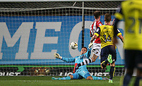 Liam McAlinden of Exeter City scores his goal past Goalkeeper Simon Eastwood of Oxford United during the The Checkatrade Trophy match between Oxford United and Exeter City at the Kassam Stadium, Oxford, England on 30 August 2016. Photo by Andy Rowland / PRiME Media Images.