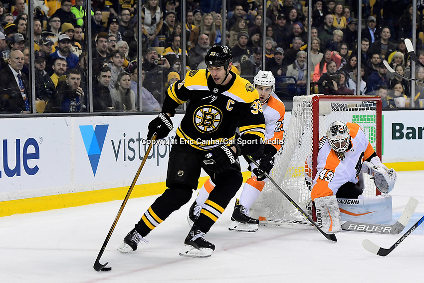 March 8, 2018: Boston Bruins defenseman Zdeno Chara (33) controls the puck at the goal lline during the NHL game between the Philadelphia Flyers and the Boston Bruins held at TD Garden, in Boston, Mass. Boston defeats Philadelphia 3-2 in regulation time. Eric Canha/CSM