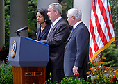 United States President George W. Bush, center, joined by US Secretary of State State Condoleezza Rice. left, and US Secretary of Defense Robert Gates, right,. delivers a statement on the Russian-Georgian conflict in South Ossetia in the Rose Garden at the White House in Washington on August 13, 2008. Bush announced he will be sending Secretary Rice to the Georgian capitol of Tbilisi. <br /> Credit: Kevin Dietsch / CNP