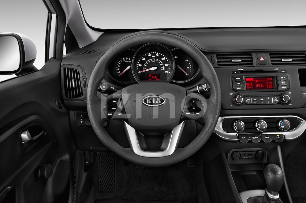 Car pictures of steering wheel view of a 2015 KIA Rio LX AT 4 Door Sedan 2WD Steering Wheel