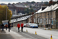 Two young Barnsley supporters walk on Grove Street outside the stadium prior to the Sky Bet Championship match between Barnsley and Swansea City at Oakwell Stadium, Barnsley, England, UK. Saturday 19 October 2019