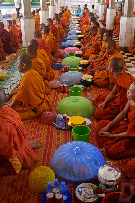 Offering during a festival in a Buddhist Temple and Monastery, Battambang, Cambodia.