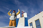 In this photo provided by the Reno Sparks Convention and Visitor's Authority, Squaw Valley skier J. T Holmes gets psyched up to perform an urban Ski-BASE jump off the roof of the Silver Legacy hotel casino in downtown Reno, Nev., Saturday Nov. 17, 2007. The stunt was to promote the local premier of the 2007 Warren Miller ski movie Playground and to raise money for the Make-a-Wish foundation, which helps make wishes come true for seriously ill children.
