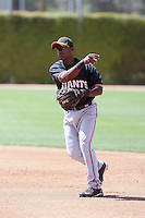 Carlos Willoughby #21 of the San Francisco Giants plays in a minor league spring training game against the Chicago Cubs at the Cubs minor league complex on March 29, 2011  in Mesa, Arizona. .Photo by:  Bill Mitchell/Four Seam Images.