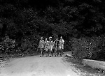 East McKeesport PA:  A view of Girl Scouts walking down a hiking trail at Camp Youghahela - 1925