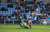 Adebayo Akinfenwa of Wycombe Wanderers shoots at Goalkeeper Reice Charles-Cook of Coventry City but the linesman flags offside during the The Checkatrade Trophy - EFL Trophy Semi Final match between Coventry City and Wycombe Wanderers at the Ricoh Arena, Coventry, England on 7 February 2017. Photo by Andy Rowland.