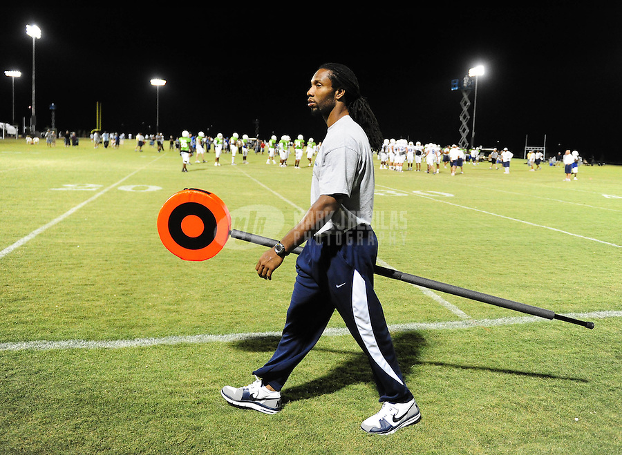 Sept. 24, 2009; Casa Grande, AZ, USA; Arizona Cardinals wide receiver Larry Fitzgerald holds the first down marker during California Redwoods practice at the Casa Grande Training Facility & Performance Institute. Mandatory Credit: Mark J. Rebilas-