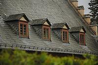 Four windows on gabbled roof. Mespelbrunn. Mespelbrunn close to Aschaffenburg, Elsava valley. Germany
