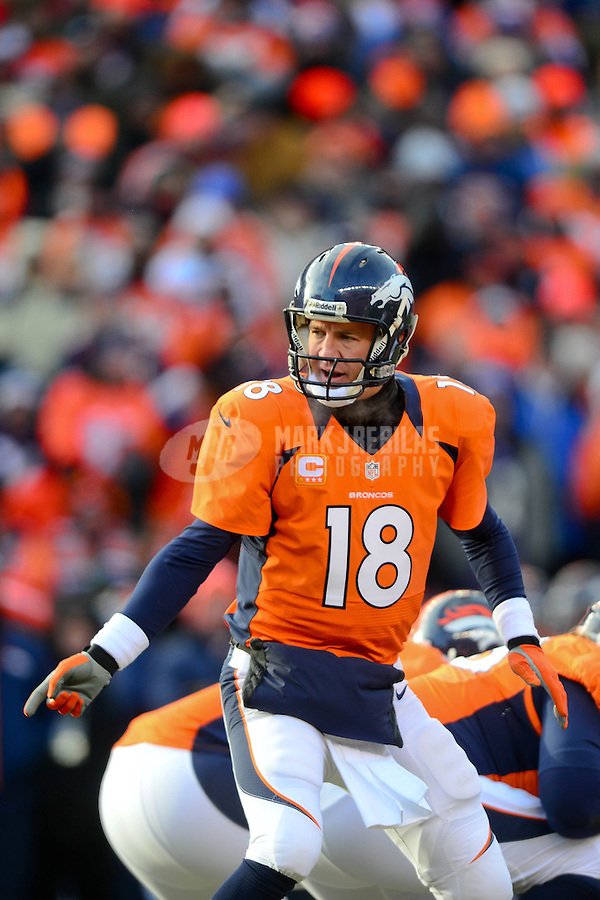 Jan 12, 2013; Denver, CO, USA; Denver Broncos quarterback Peyton Manning (18) calls a play in the first quarter against the Baltimore Ravens during the AFC divisional round playoff game at Sports Authority Field.  Mandatory Credit: Mark J. Rebilas-
