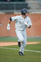 Roman Collins (15) of the Florida Atlantic Owls hustles down the first base line against the Charlotte 49ers at Hayes Stadium on March 14, 2015 in Charlotte, North Carolina.  The Owls defeated the 49ers 8-3 in game one of a double header.  (Brian Westerholt/Four Seam Images)