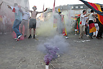 30 June 2006: Fans dance around colored smoke bombs as Germany fans celebrate in the town square in Frankfurt, site of several games during the FIFA 2006 World Cup. Germany had just defeated Argentina in a Quarterfinal game played in Berlin.