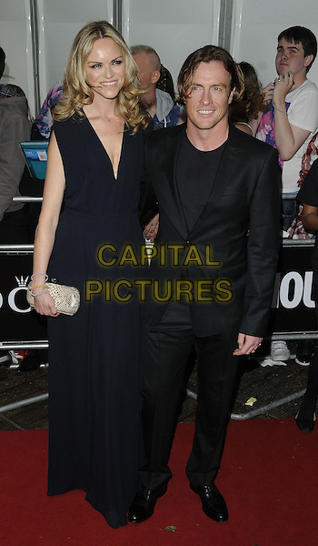 Anna-Louise Plowman &amp; Toby Stephens<br /> Glamour Women of the Year Awards at Berkeley Square Gardens, London, England.<br /> full length black suit dress<br /> CAP/CAN<br /> &copy;Can Nguyen/Capital Pictures