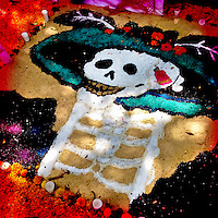 A female skeleton image made of sand, representing a Mexican cultural icon called La Calavera Catrina, forms a part of the public altar (ofrenda) seen on the street during the celebrations of the Day of the Dead (Día de Muertos) in Morelia, Michoacán, Mexico, 2 November 2014.